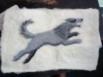 Needle-felted Stark direwolf banner.