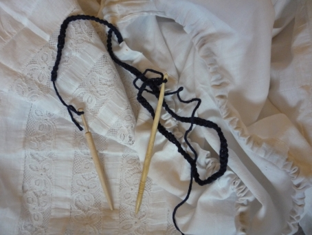Drawstring crocheted with bone hook, tied to Honiton bobbin and drawn through channel. The lace is from the bottom of the petticoat.