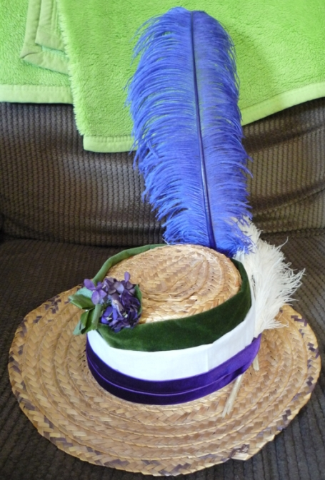 Suffragette hat trimmed.